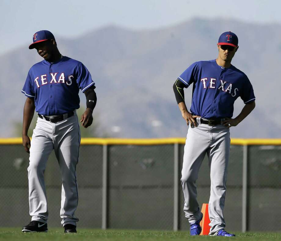 "The Rangers, whose pitchers include Neftali Feliz (left) of the Dominican Republic and Yu Darvish of Japan, ""want the best players regardless where they're from,"" GM Jon Daniels said. Photo: Tony Gutierrez / Associated Press / AP"