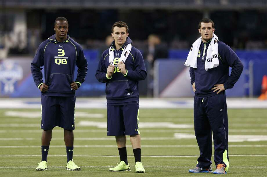 The Texans must decide if Texas A&M and Kerrville Tivy High product Johnny Manziel (middle) is worthy of the No. 1 pick. Photo: Joe Robbins / Getty Images / 2014 Getty Images