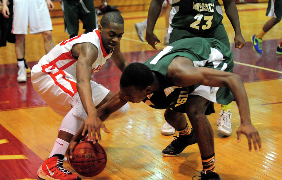 Bassick's Kobe Ancrum tries to steal a loose ball away from Greenwich's Leonel Hyatt, left, during boys basketball action in Greenwich, Conn. on Wednesday February 26, 2014. Photo: Christian Abraham / Connecticut Post