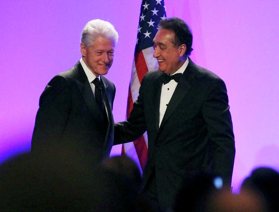 Former President Bill Clinton helped honor former Secretary of Housing appointee and friend Henry Cisneros (right). Photo: Kin Man Hui, San Antonio Express-News / ©2013 San Antonio Express-News