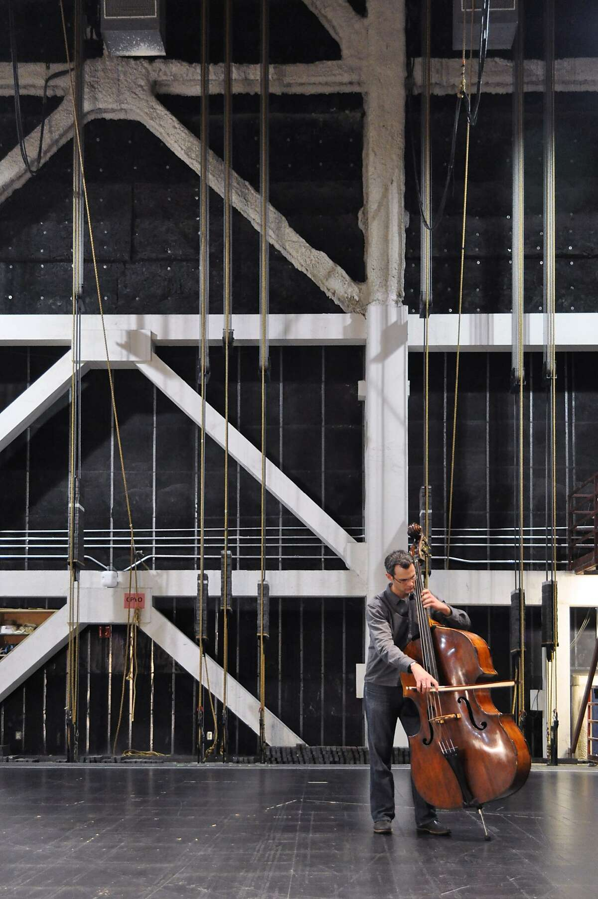 San Francisco Symphony principal bassist Scott Pingel warms up in the future site of SoundBox, the new experimental performance venue opening at Davies Symphony Hall in December.