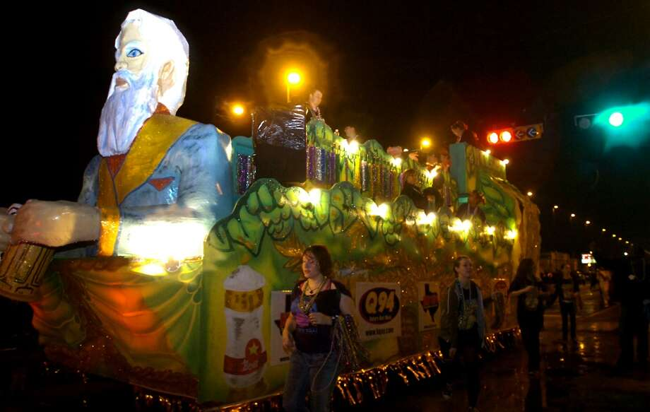 A float goes by during the Mardi Gras parade in Port Arthur, Saturday, February 18, 2012. Tammy McKinley/The Enterprise