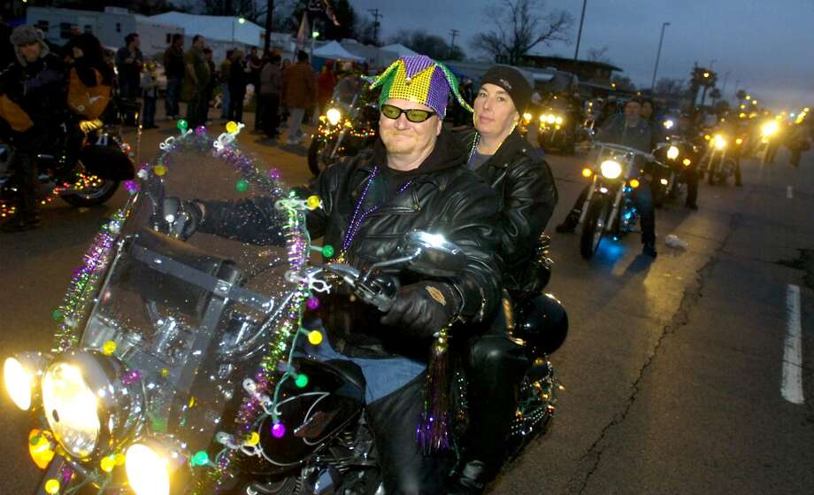 A parade of motorcycles kicks off the evenings Mardi Gras festivities in Port Arthur, Saturday, February 18, 2012. Tammy McKinley/The Enterprise