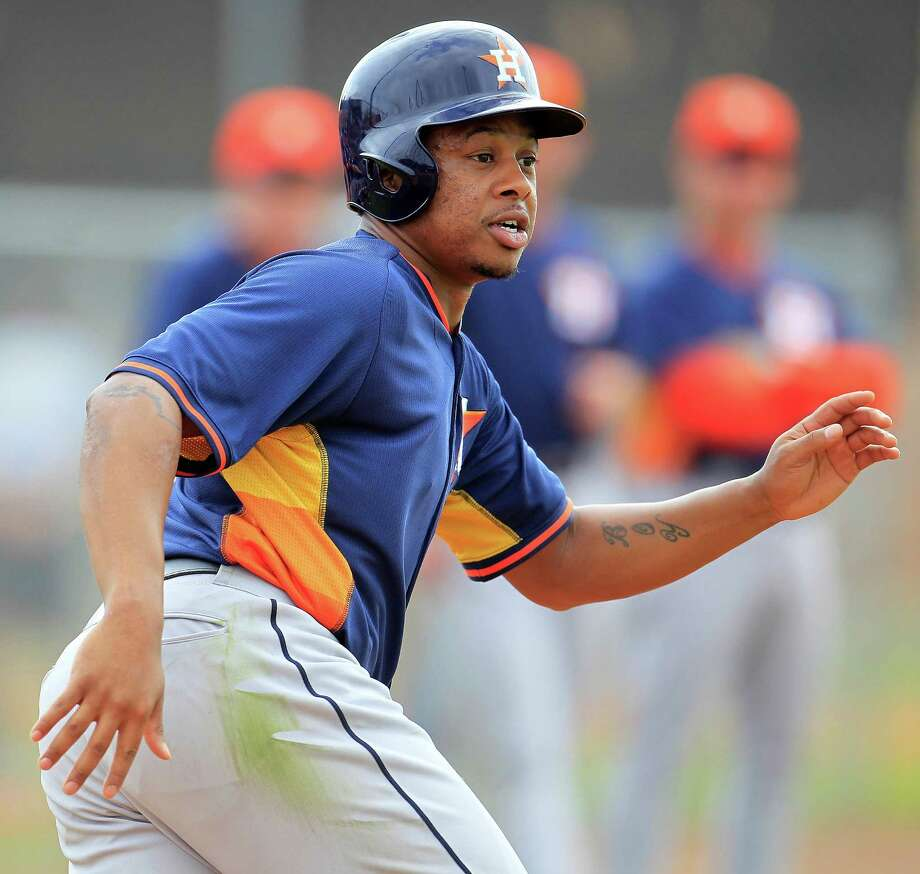 Former Cardinal Adron Chambers is trying to stick with the Astros after turning to baseball when his college football career came to an abrupt end. Photo: Karen Warren, Staff / © 2013 Houston Chronicle