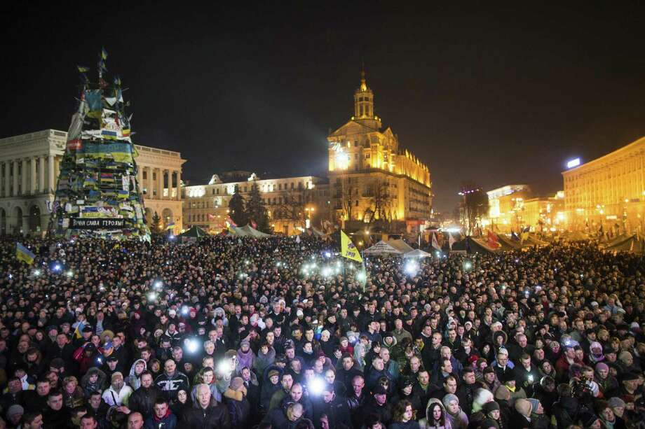 Crowds gather in Kiev to watch a presentation of new ministers of Ukraine's government. Secretary of State John Kerry announced that the U.S. was planning $1 billion in loan guarantees for the nation. Photo: Photos By Uriel Sinai / New York Times / NYTNS