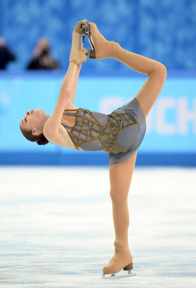 BEST: Gold medal winner  Adelina Sotnikova  performs on  Feb.20 in a cobweb gray and glittery gold-bronze web pattern -- both warm and cool in tone -- in Sochi.  (AFP PHOTO / YURI KADOBNOVYURI KADOBNOV/AFP/Getty )Images Photo: YURI KADOBNOV, AFP/Getty Images