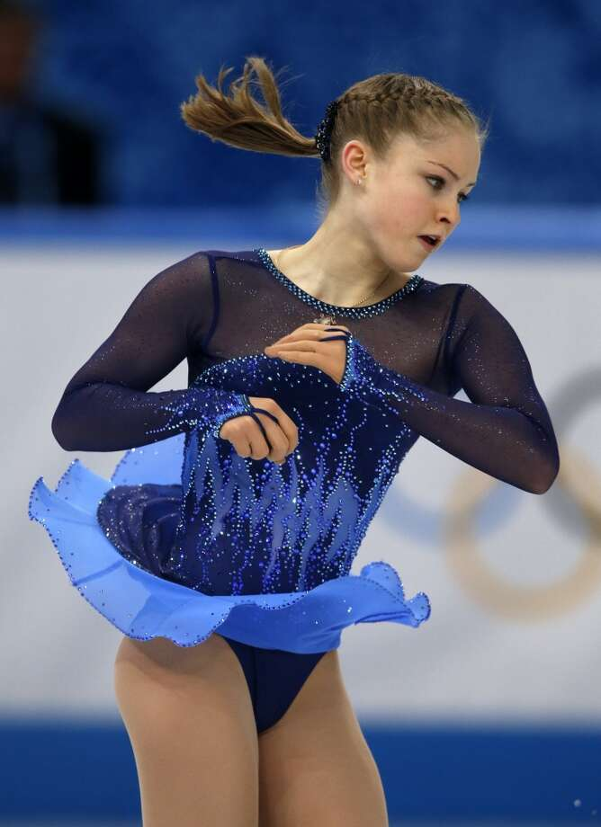 BEST: Julia Lipnitskaia of Russia has a winning dress -- sheer arms add elegance and don't overpower the patterned bodice and electric blue skirt. Photo: ADRIAN DENNIS, AFP/Getty Images