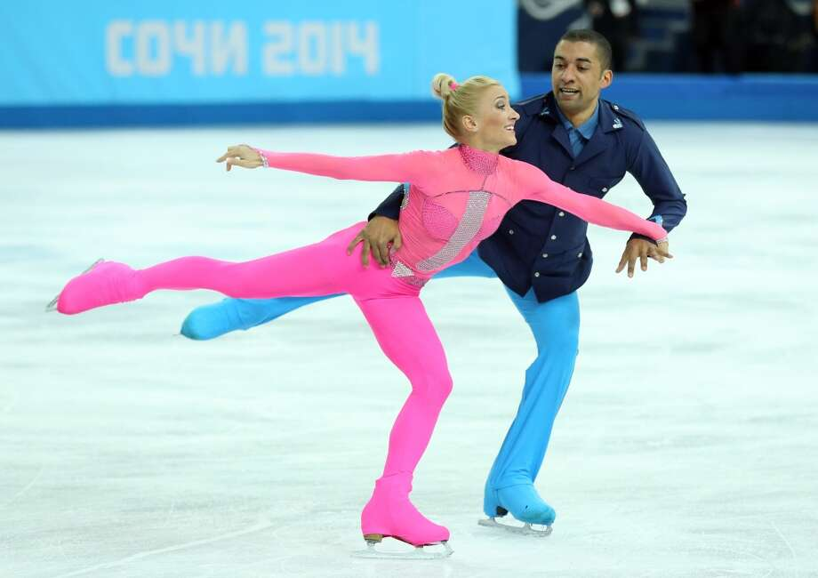 "WORST: Skating to the ""Pink Panther,"" Germany's Aliona Savchenko and Robin Szolkowy took the costuming a bit too literally in the pairs competition Feb. 11. With apologies to the late Peter Sellers, this Pepto Bismol pink unitard and neon blue military jacket combo is as bumbling as Inspector Clouseau. Photo: John Berry, Getty Images"