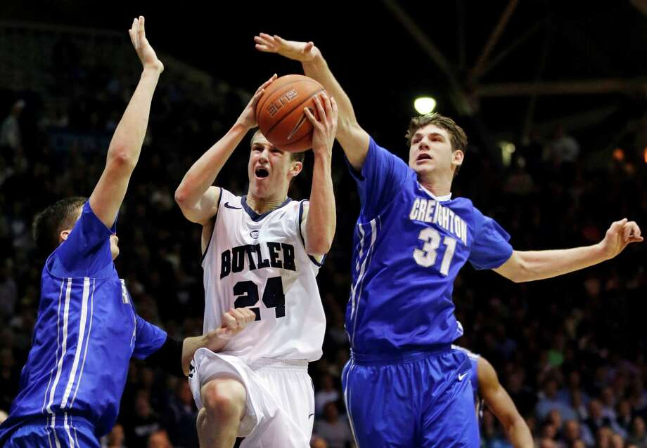 Butler guard Kellen Dunham, center, shoots between Creighton forward Doug McDermott, left, and center Will Artino in the second half of an NCAA college basketball game in Indianapolis, Thursday, Feb. 13, 2014. Creighton won 68-63. (AP Photo/Michael Conroy) ORG XMIT: INMC110 Photo: Michael Conroy / AP