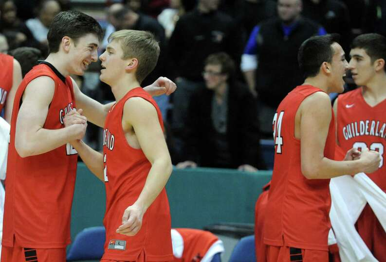 Guilderland celebrate after defeating Columbia after five overtimes in their  Class AA boys' basketb