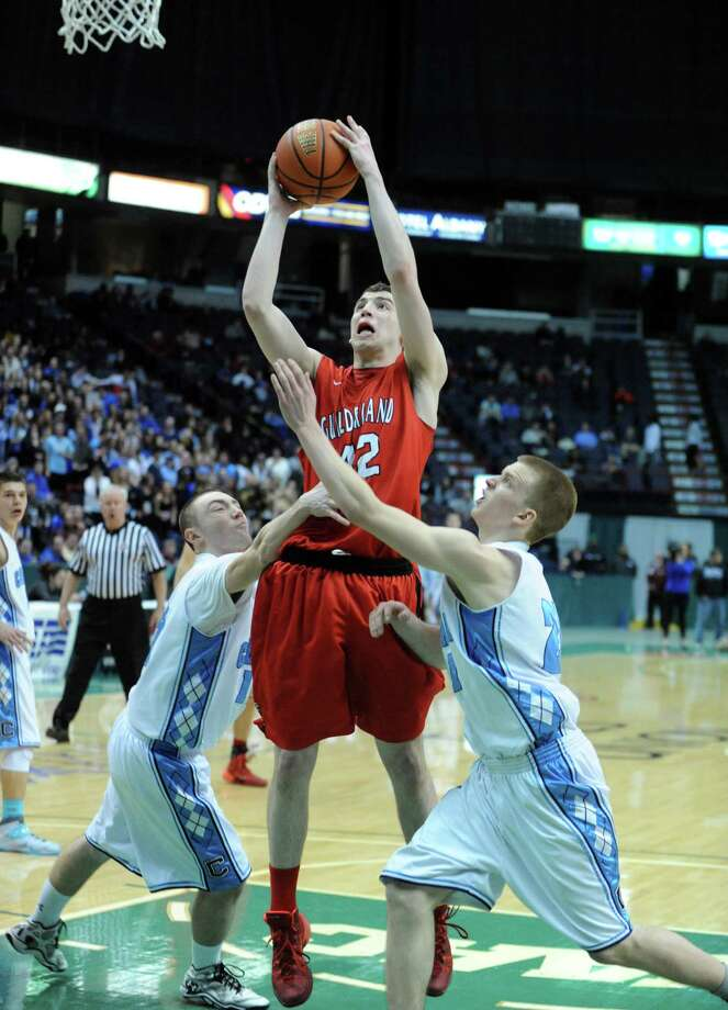 Guilderland's Marc DuMoulin goes in for a score during their Class AA boys' basketball semifinal against Columbia at the Times Union Center on Wednesday Feb. 26, 2014 in Albany, N.Y. (Michael P. Farrell/Times Union) Photo: Michael P. Farrell / 00025909A