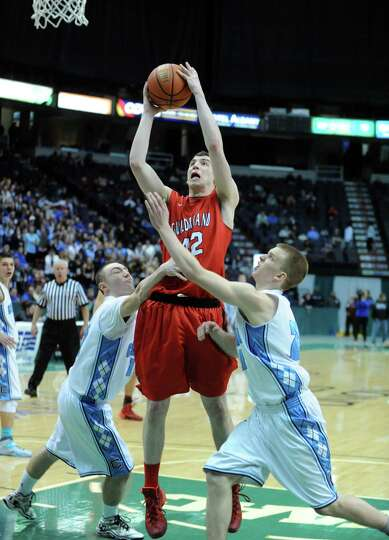 Guilderland's Marc DuMoulin goes in for a score during their Class AA boys' basketball semifinal aga