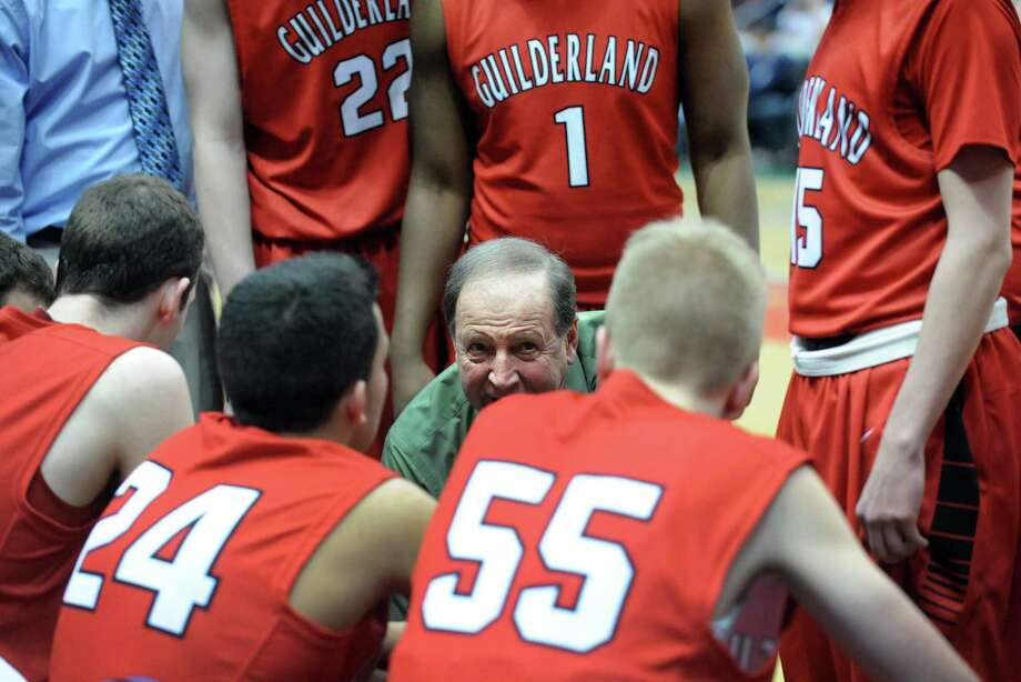 Guilderland coach Ron Osinski talks with his team during the final overtime as his team went on to defeat Columbia after five overtimes in their Class AA boys' basketball semifinal at the Times Union Center on Wednesday Feb. 26, 2014 in Albany, N.Y. (Michael P. Farrell/Times Union) Photo: Michael P. Farrell / 00025909A