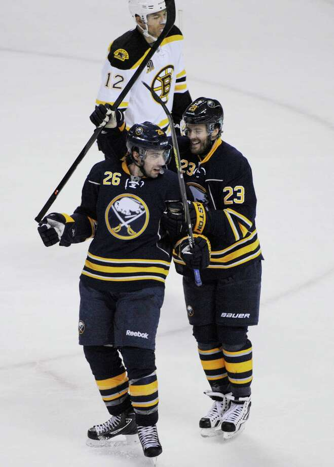 Buffalo Sabres' Matt Moulson (26) celebrates with teammate Ville Leino (23) after scoring the game-tying goal against the Boston Bruins during the third period of an NHL hockey game in Buffalo, N.Y., Wednesday, Feb. 26,  2014. Buffalo won in overtime 5-4.  (AP Photo/Gary Wiepert) ORG XMIT: NYGW109 Photo: Gary Wiepert / FR170498 AP