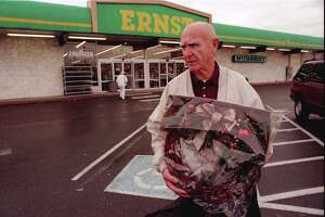 Local chain  Ernst Home Center  began in Seattle in the late 1800s and died a century later, in the late 1990s, bleeding to places like Home Depot and Eagle Hardware. A customer is pictured outside the University Village Ernst in 1996, during the store's liquidation sale.