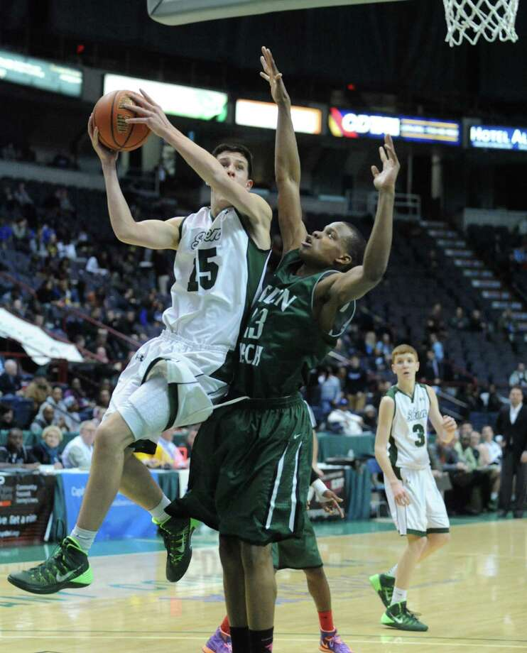 Shen's Thomas Huerter goes in for a score during their Class AA boys' basketball semifinal against Green Tech at the Times Union Center on Wednesday Feb. 26, 2014 in Albany, N.Y. (Michael P. Farrell/Times Union) Photo: Michael P. Farrell / 00025908A