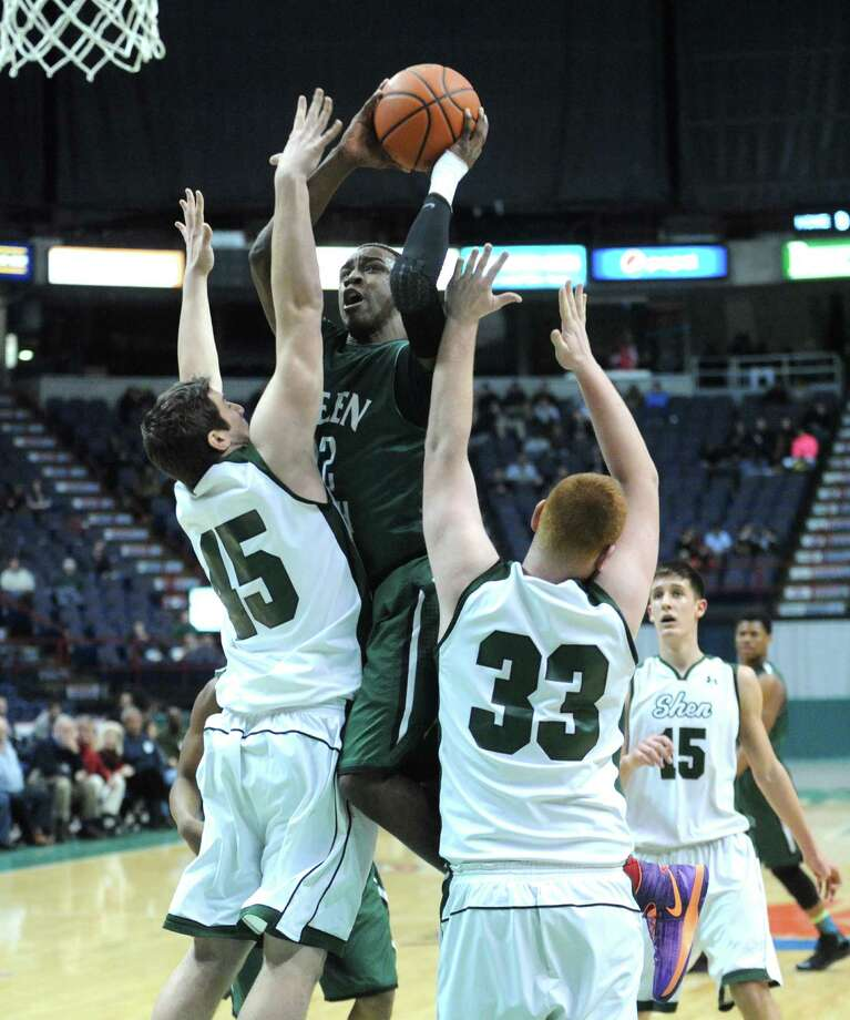 Green Tech's Jamil Hood Jr. goes in for a score during their Class AA boys' basketball semifinal against Shen at the Times Union Center on Wednesday Feb. 26, 2014 in Albany, N.Y. (Michael P. Farrell/Times Union) Photo: Michael P. Farrell / 00025908A