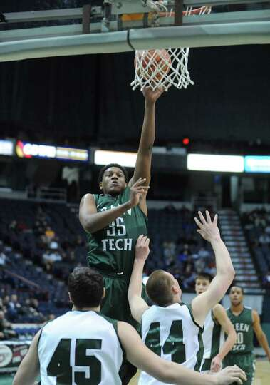 Green Tech's Ramion Burt goes in for a score during their Class AA boys' basketball semifinal agains