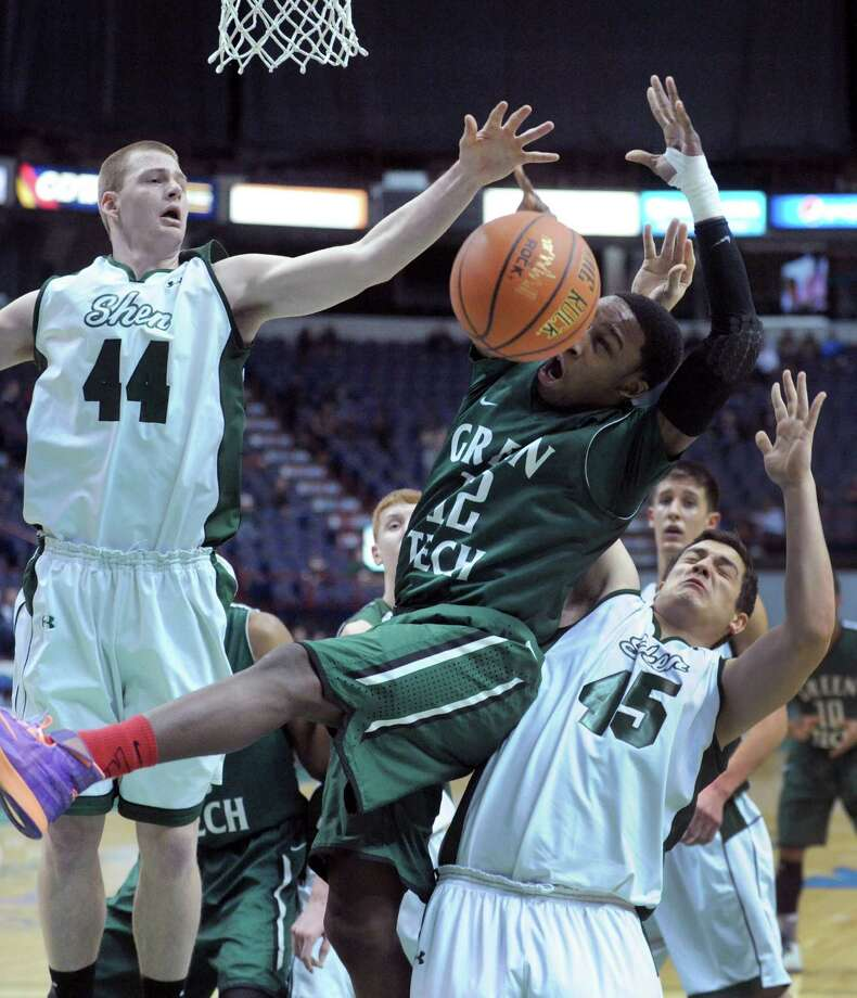 Green Tech's Jamil Hood Jr. runs into a wall of Shen defenders during their Class AA boys' basketball semifinal at the Times Union Center on Wednesday Feb. 26, 2014 in Albany, N.Y. (Michael P. Farrell/Times Union) Photo: Michael P. Farrell / 00025908A