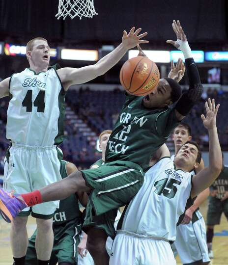 Green Tech's Jamil Hood Jr. runs into a wall of Shen defenders during their Class AA boys' basketbal