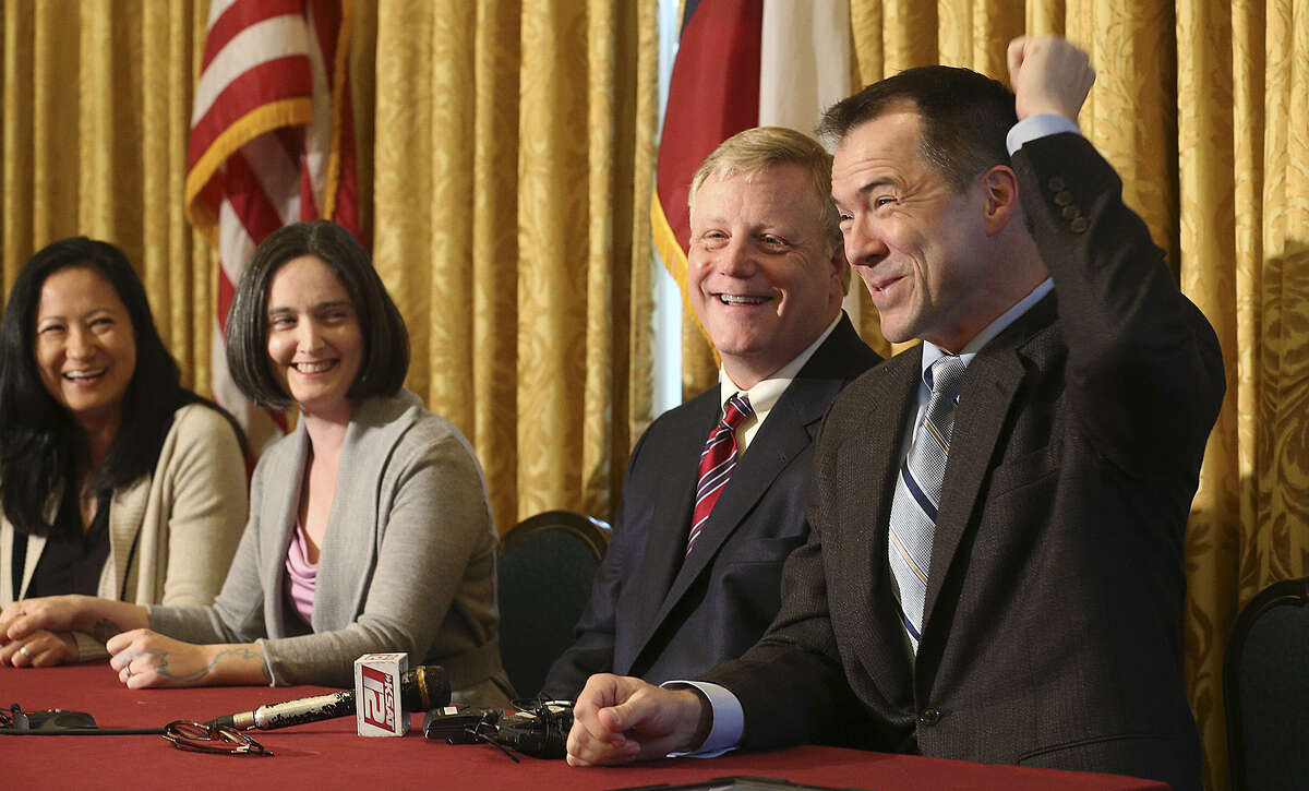Cleo De Leon (from left) and Nicole Dimetman, along with Mark Phariss and Victor Holmes, two gay couples, discuss federal Judge Orlando Garcia's decision on the state constitution's definition of marriage.