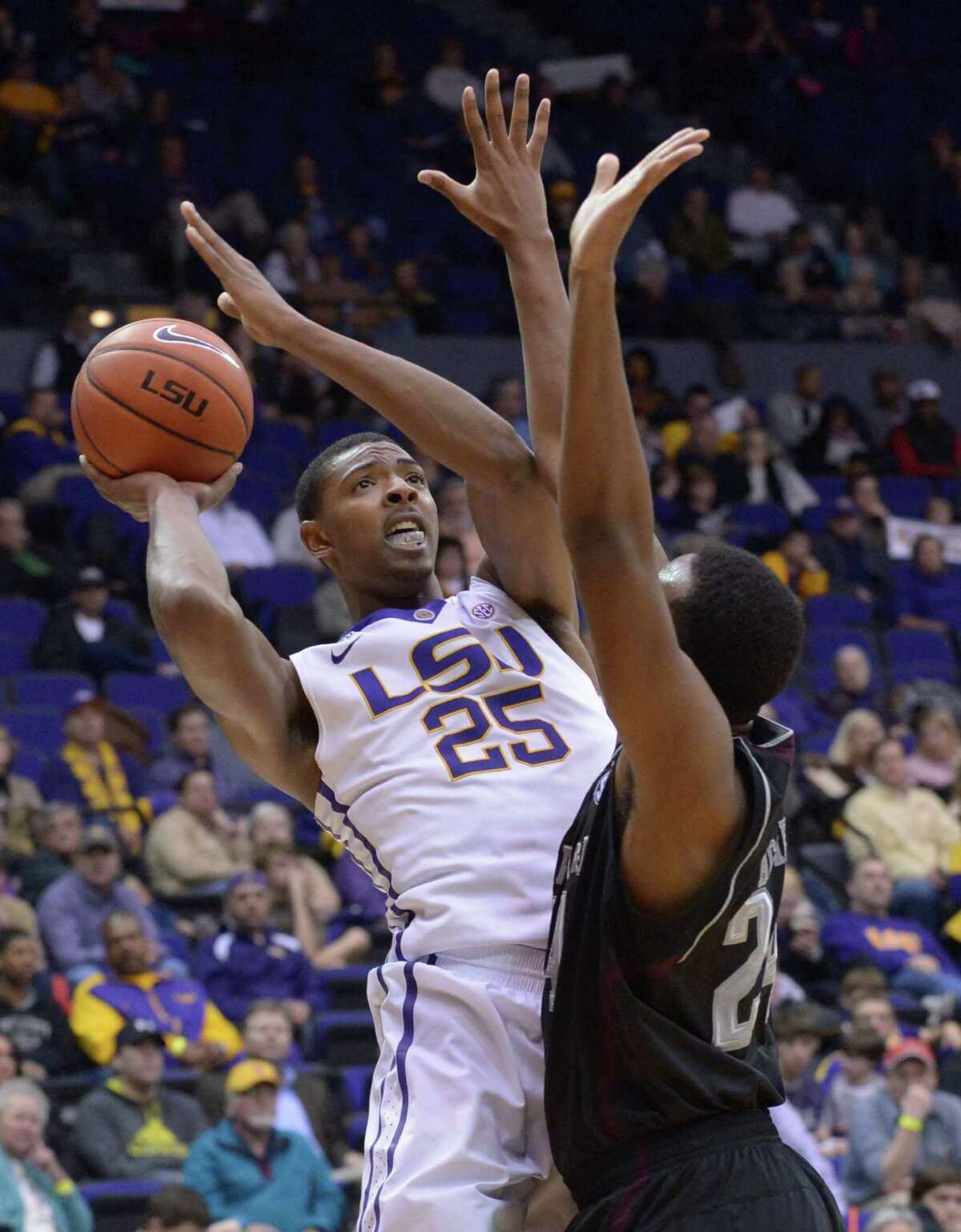 LSU's Jordan Mickey is blocked by a Texas A&M player during an NCAA college basketball game Wednesday, Feb. 26, 2014, in Baton Rouge, La.(AP Photo/The Baton Rouge Advocate, Heather McClelland)