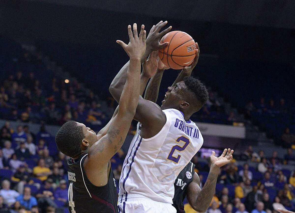 LSU's Johnny O'Bryant is fouled by Texas A&M's Shawn Smith during an NCAA college basketball game Wednesday, Feb. 26, 2014, in Baton Rouge, La.(AP Photo/The Baton Rouge Advocate, Heather McClelland)