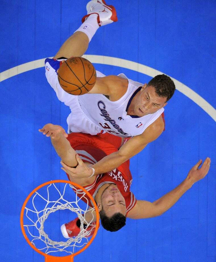 Clippers forward Blake Griffin, top, puts up a shot as Rockets forward Donatas Motiejunas, of Poland, defends. Photo: Mark J. Terrill, Associated Press