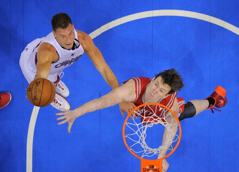Clippers forward Blake Griffin, left, puts up a shot as Rockets center Omer Asik, of Turkey, defends. Photo: Mark J. Terrill, Associated Press