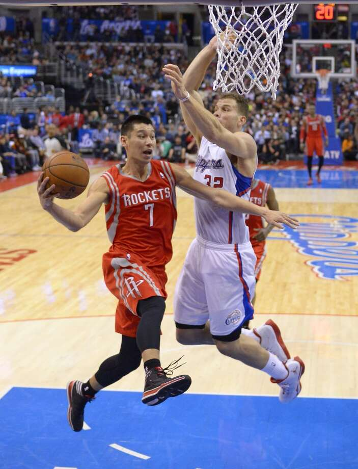 Rockets guard Jeremy Lin, left, passes the ball as Clippers forward Blake Griffin defends. Photo: Mark J. Terrill, Associated Press