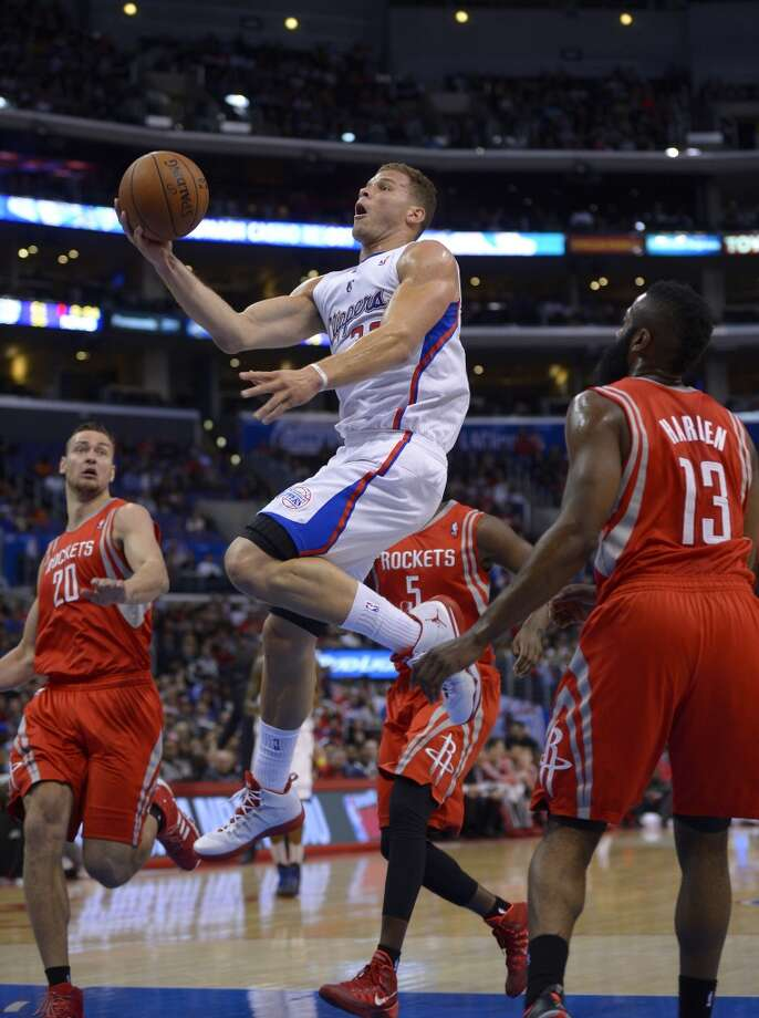 Clippers forward Blake Griffin, second from left, goes up for a shot as Rockets forward Donatas Motiejunas, left, of Poland, forward Jordan Hamilton, second from right, and guard James Harden defend. Photo: Mark J. Terrill, Associated Press
