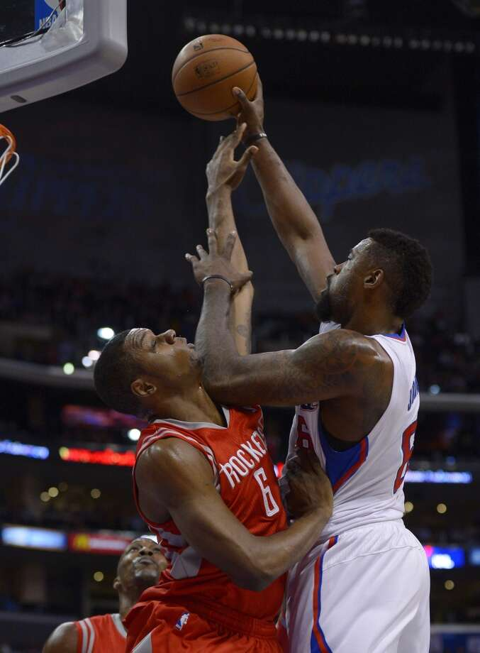 Clippers center DeAndre Jordan, right, puts up a shot as Rockets forward Terrence Jones defends. Photo: Mark J. Terrill, Associated Press