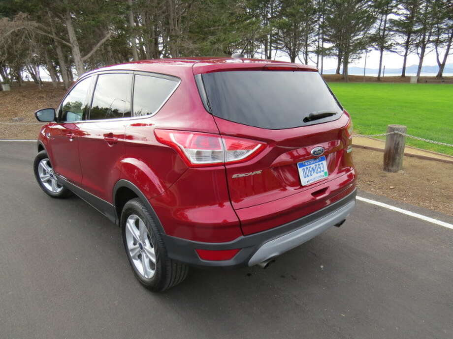 The Ford gold-star gizmo of the day is this: you're loaded down with a huge sheetcake, so both hands are full. As you gingerly approach the back of the car, ensuring that you have the keyfob in your pocket, you move your foot under the rear bumper and, voila!, the power-operated tailgate lifts up. Not bad.
