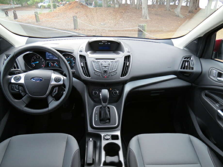 """Inside, the Escape has the requisite Ford edgy high-tech audio and phone """"Sync Voice Activated System,"""" which takes some learning. Every time I've tested a Ford product, it has come with complicated center-stack technology which, when it works, is fine, even as it takes a while to figure it out."""