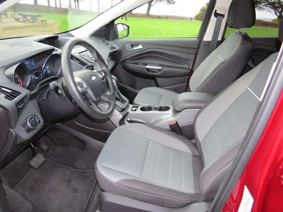Driver and shotgun seat passenger have plenty of room.