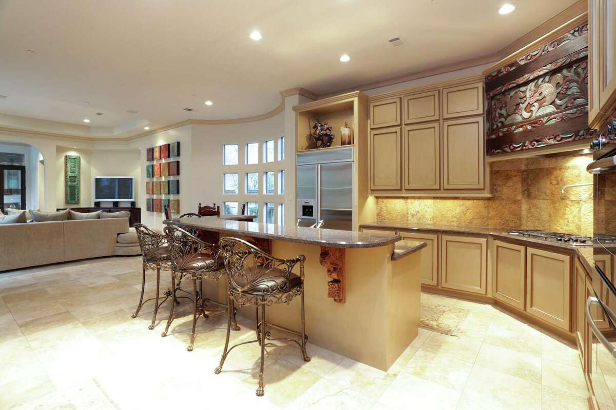 The spacious kitchen features granite countertops and plenty of cabinet space.