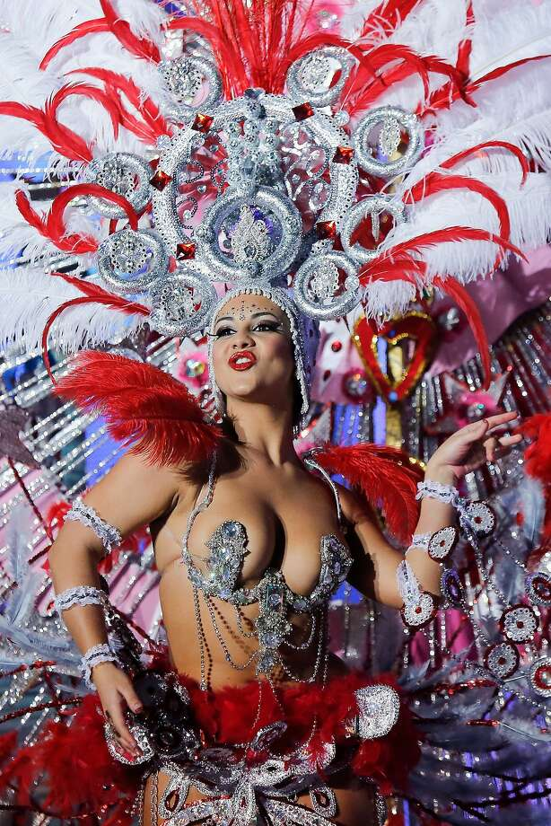 Canary island flashes its feathers:Nominee for Queen of the 2013 Santa Cruz carnival Veronica Gil Perez performs in Santa Cruz de Tenerife on the Canary island of Tenerife, Spain. The Carnival of Santa Cruz de Tenerife is the closest European equivalent to the Brazilian Carnival in Rio Janeiro. Photo: Pablo Blazquez Dominguez, Getty Images
