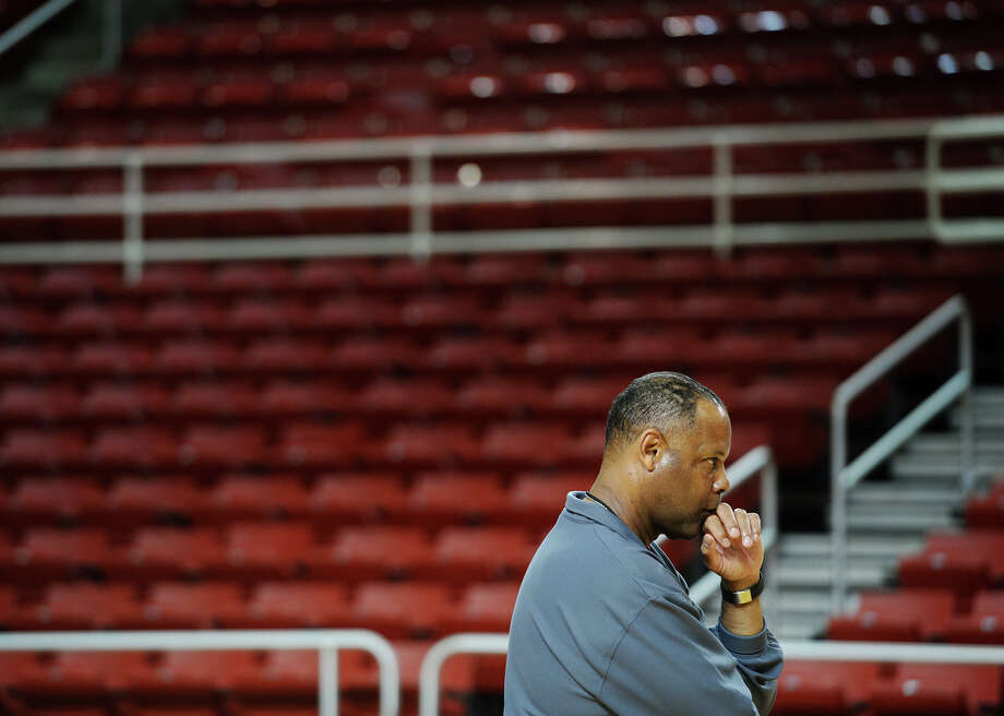 Tic Price watches the Lamar men's basketball team run drills during practice Wednesday afternoon. Lamar University has position Tic Price as the interim head coach for the men's basketball team. Photo taken Wednesday, 2/19/14 Jake Daniels/@JakeD_in_SETX Photo: Jake Daniels / ©2013 The Beaumont Enterprise/Jake Daniels