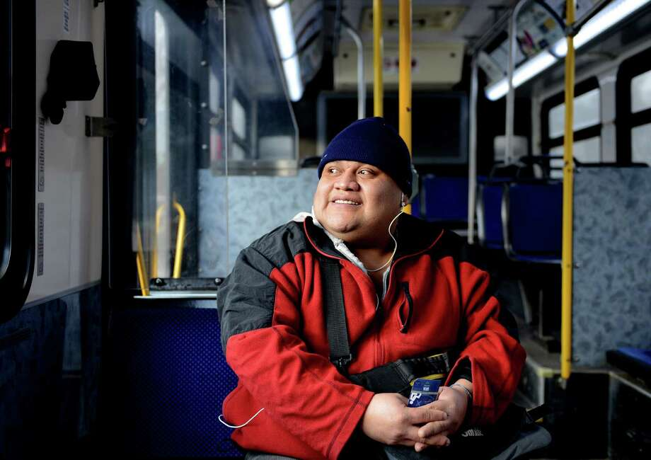 Felix Romeo Torres, of Bridgeport, looks out the window as he rides Greater Bridgeport Transit's new Route 20 bus which provides service to Monroe via Rt. 111 and Rt. 25 Tuesday, Feb. 25, 2014.  For Torres, the new route has greatly reduced the distance he has to walk to reach the bus stop. Photo: Autumn Driscoll / Connecticut Post
