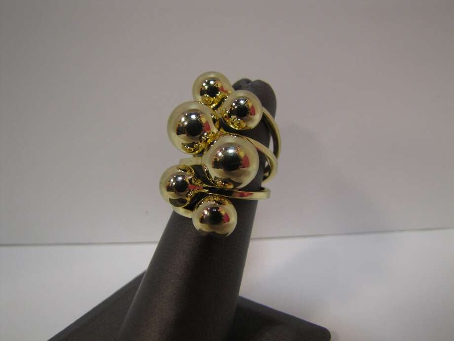 Gold-tone cluster ring, $11.97, AGK s Jewelry Box, Beaumont Photo: Cat5