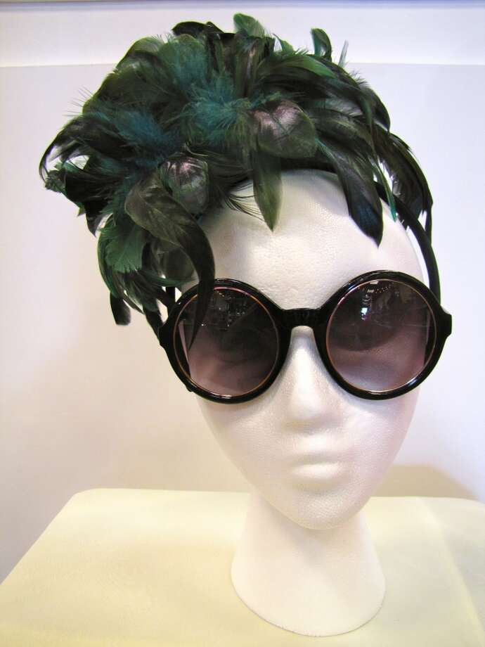 Feather fascinator, $14.97; Round sunglasses, $12.25. AGK s Jewelry Box, Beaumont Photo: Cat5