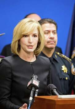 "Harris County District Attorney Devon Anderson and Sheriff Adrian Garcia on right talk to the media about an upcoming ""no refusal"" weekend in this Feb. 27, 2014 file photo. A ruling from an appeal court may mean the end of ""no refusal weekends."" Photo: Craig Hartley, For The Chronicle / Copyright: Craig H. Hartley"