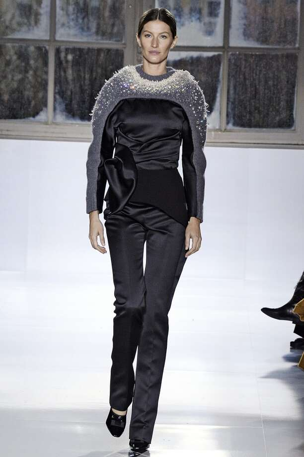 Supermodel Gisele Bundchen walks the runway at the Balenciaga Autumn Winter 2014 fashion show during Paris Fashion Week on February 27, 2014 in Paris, France. Photo: Catwalking, Getty Images