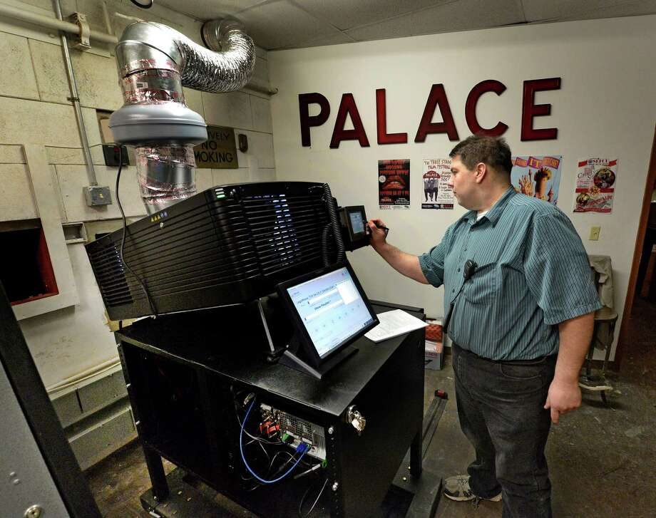 Projectionist Chip Ordway starts up the new Palace Theatre digital projection system Thursday, Feb. 27, 2014, during a press conference at the Palace Theatre in Albany, N.Y. (Skip Dickstein / Times Union) Photo: SKIP DICKSTEIN / 00025818A