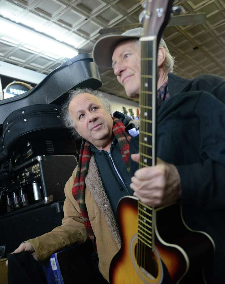 Guitar virtuouso Arlen Roth, left, and Music Guild store owner Russ Mumma speak at the Music Guild in Danbury, Conn. Thursday, Feb. 27, 2014.  Mumma is donating 15 guitars to Roth so he can give them to inner-city children in Asbury Park, N.J. as part of his vision to create the International Guitar Hall of Fame and Museum in Asbury Park and spread the love of music throughout the community. Photo: Tyler Sizemore / The News-Times