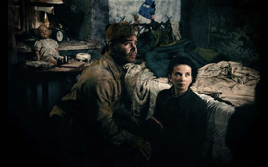 "This image released by Sony Pictures shows Philippe Reinhardt, left, and Mariya Smolnikova in a scene from ""Stalingrad."" (AP Photo/Sony Pictures) ORG XMIT: NYET911 Photo: ©NON-STOP PRODUCTION / Sony Pictures"