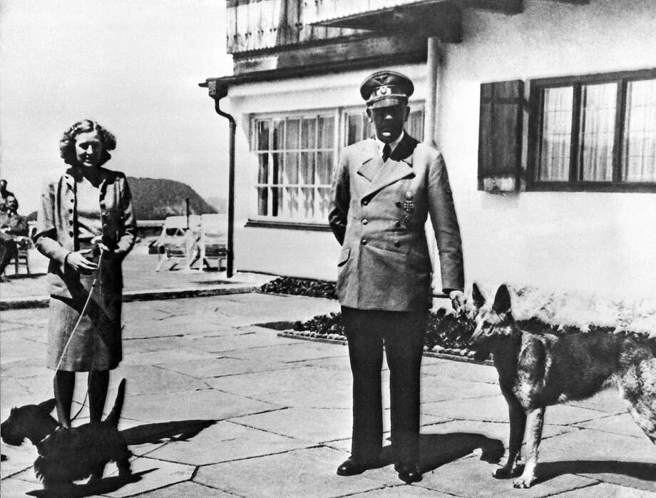 Adolf Hitler and his mistress Eva Braun pose on the Terrace of the Berghof, Berchtesgaden in Germany. The residence was Hitler's mountain retreat in Bavaria. Photo: AP