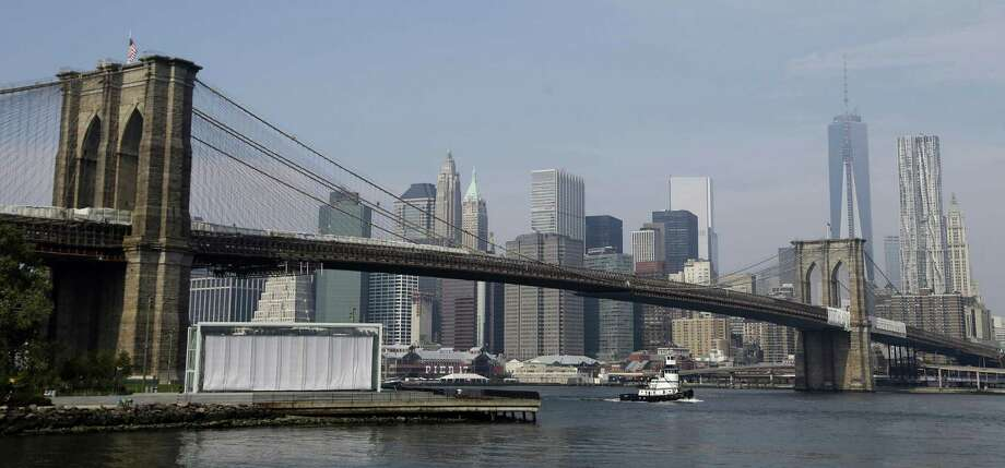 The Brooklyn Bridge in New York (pictured) was completed in 1883, the same year as the world's first rodeo in Pecos, Texas.It's worth noting that the Brooklyn Bridge is actually older than London's Tower Bridge by 11 years. Photo: Seth Wenig, STF / AP