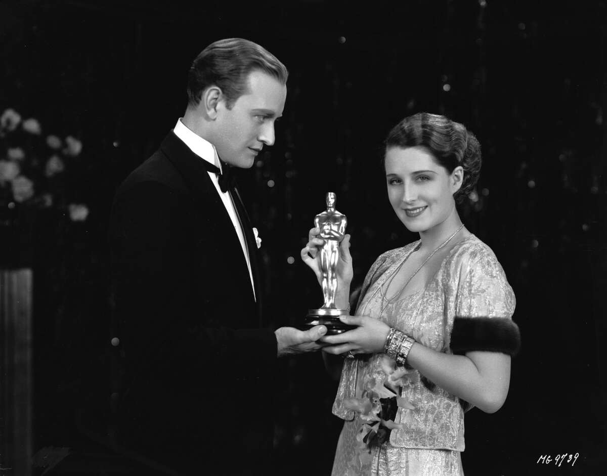 The Academy Awards have always been full of glittering gowns, dramatic hairdos, strange accessories and overly-tanned skin. These vintage shots look back at awards ceremonies from the 1930s to the 1980s. This photo: Canadian star Norma Shearer in 1930.