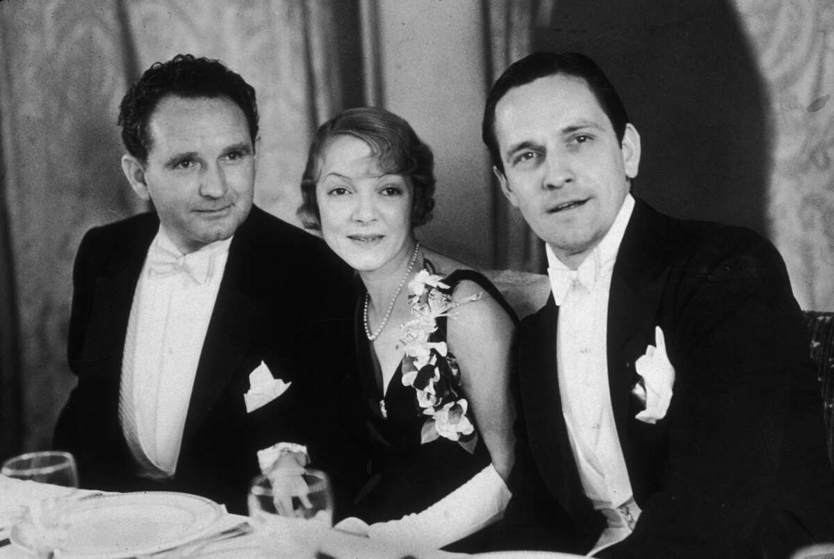 American film director Frank Borzage and actors Helen Hayes and Fredric March in 1932.